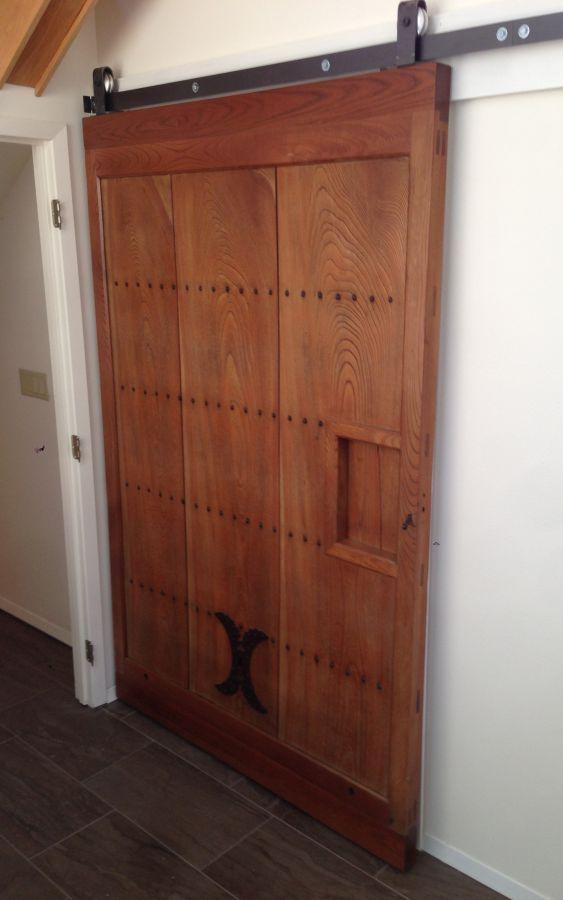 A restored Japanese Kura door turned into a sliding door. click to enlarge & Built-ins Portfolio | Madera Furniture Company