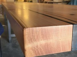 Detail of 20' long table for Tacoma Restaurant, The Table. Douglas Fir and Blackened Steel